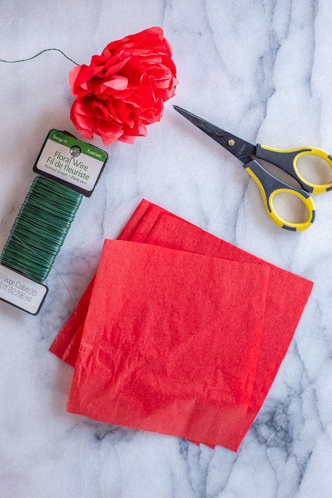 the supplies needed to make tissue paper flowers