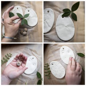 Child pressing nature materials into clay.